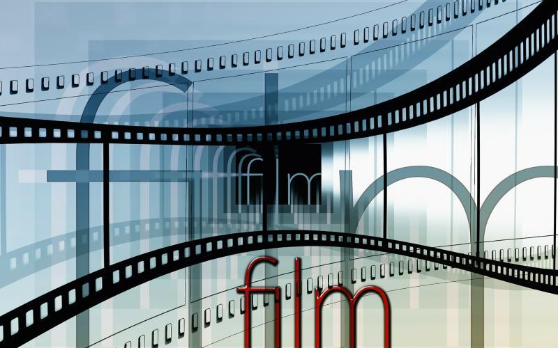 """Das Bild zeigt eine Filmrolle und den Schriftzug """"Film""""."""